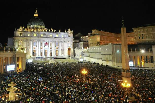 A general view shows the crowd at St Peter's Square after white smoke billowed from the chimney of the Sistine Chapel announcing that Catholic Church cardinals had elected a new pope during a conclave on March 13, 2013 at the Vatican. Photo: AFP, AFP/Getty / 2013 AFP