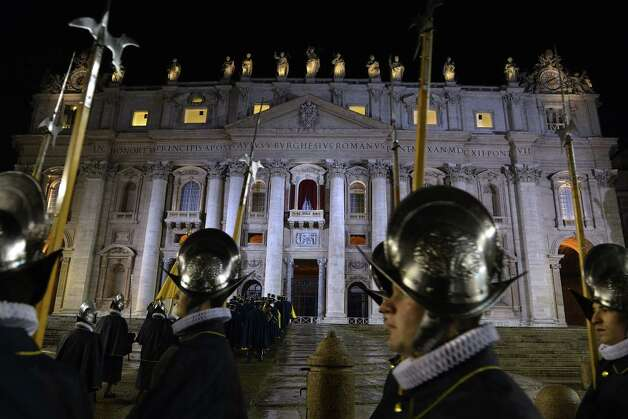 Swiss guards arrive while the balcony where the new pope will appear is seen in the background minutes after white smoke rose from the chimney on the roof of the Sistine Chapel (not pictured) meaning that cardinals elected a new pope on the second day of their secret conclave on March 13, 2013 at the Vatican. Photo: AFP, AFP/Getty / 2013 AFP