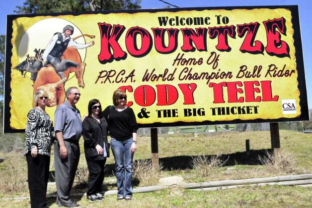 Driving into Kountze, from both sides, drivers can now see a sign honoring the town s hometown hero. One of the signs recognizing World Champion Bull Rider Cody Teel, who won the 2012 National Finals Rodeo in December, can be see off Highway 69 near the city s park. Teel s mom, Kami Teel, saw the sign for the first time Thursday and said she got a  little emotional  pulling up to it and was honored to see her son recognized. She was joined Thursday by Ira Braneff, Kountze Chamber of Commerce interim president, Lesia Jones, Hardin County court clerk, and family friend Rachael Coe. Photos by Cassie Smith. Photo: Cassie Smith