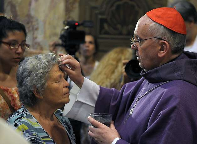 Argentine Archbishop Jorge Bergoglio (right) draws the cross on the forehead of a believer during a mass for Ash Wednesday, opening Lent, the forty-day period of abstinence and deprivation for the Christians, before the Holy Week and Easter, on February 13, 2013 at the Metropolitan Cathedral in Buenos Aires, Argentina. Bergoglio is a candidate to succeed Pope Benedict XVI.  Photo: Juan Mabromata, AFP/Getty Images