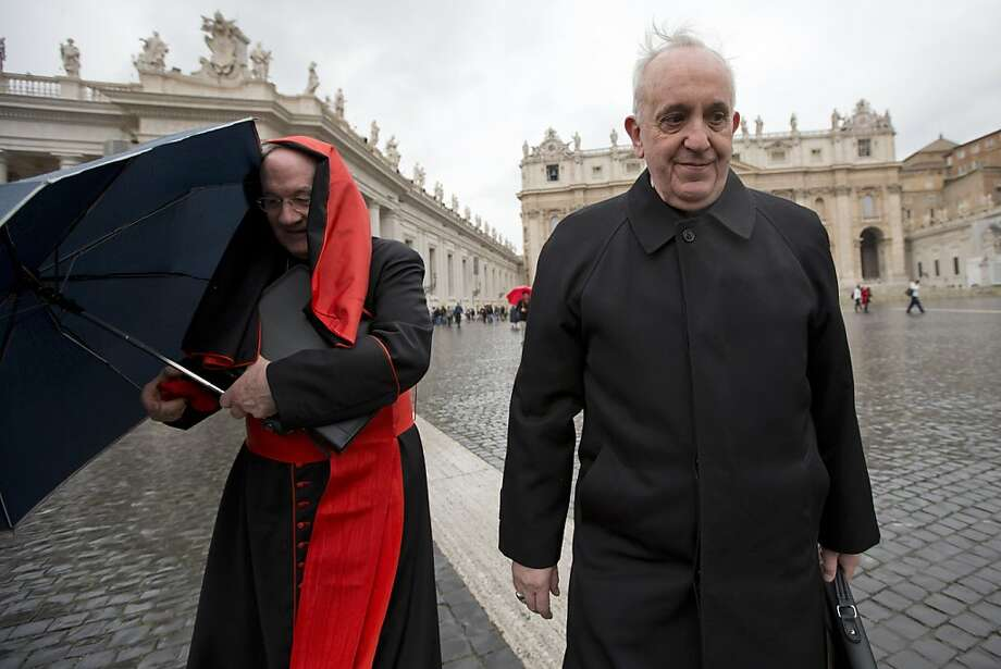 Canadian Cardinal Marc Ouellet, left, holds on to his umbrella next to Argentine Cardinal Jorge Mario Bergoglio as they walk in St. Peter's Square after attending a cardinals' meeting, at the Vatican, Wednesday, March 6, 2013. Cardinals are meeting to discuss the problems of the church and to get to know one another because there is no clear front-runner in the election of the new pope. Photo: Andrew Medichini, Associated Press
