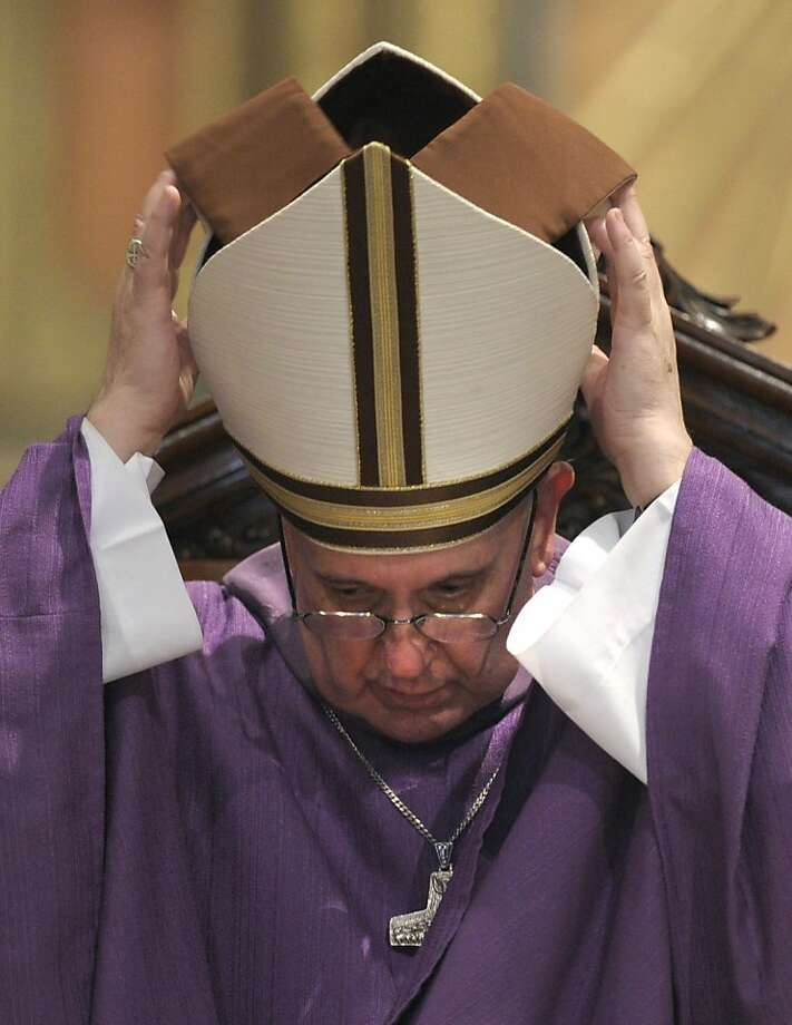 Argentine Archbishop Jorge Bergoglio adjusts his mitre during a mass for Ash Wednesday, opening Lent, the forty-day period of abstinence and deprivation for the Christians, before the Holy Week and Easter, on February 13, 2013 at the Metropolitan Cathedral in Buenos Aires, Argentina. Bergoglio is a candidate to succeed Pope Benedict XVI. Photo: Juan Mabromata, AFP/Getty Images