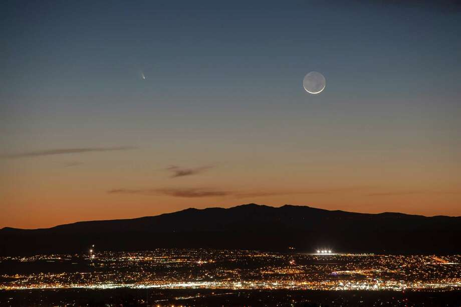 Comet Pan-STARRS is seen over the western horizon and just above Mount Taylor, from Albuquerque, N.M., Tuesday evening, March 12, 2013. The comet passed within 100 million miles of Earth last week.  (AP Photo/Albuquerque Journal, Morgan Petroski)  Photo: Associated Press