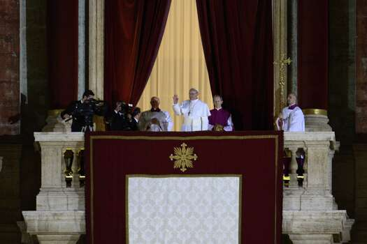 Argentina's Jorge Bergoglio, elected Pope Francis I (C) appears at the window of St Peter's Basilica's balcony after being elected the 266th pope of the Roman Catholic Church on March 13, 2013 at the Vatican. Photo: AFP, Getty / 2013 AFP