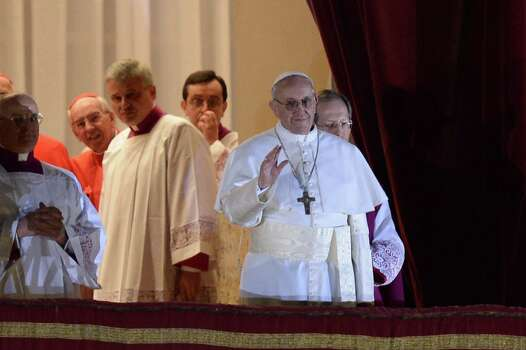 New Pope, Argentinian cardinal Jorge Mario Bergoglio appears at the window of St Peter's Basilica's balcony after being elected the 266th pope of the Roman Catholic Church on March 13, 2013 at the Vatican. Photo: AFP, Getty / 2013 AFP
