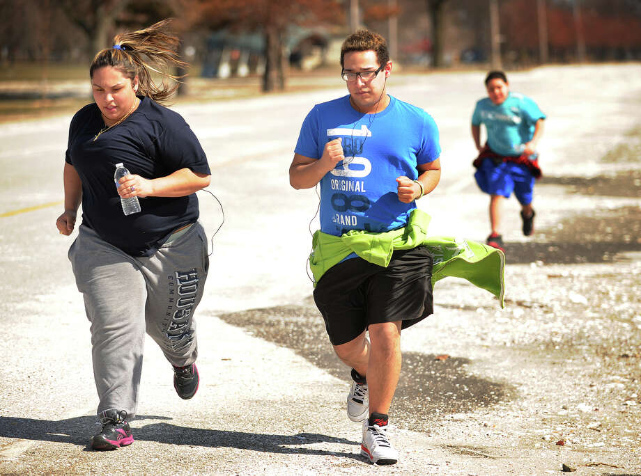 From left; Ashley Duarte, 17, Elvin Agosto, 15, and Fabian Agosto, 11, of Bridgeport, go for a run at Seaside Park in Bridgeport on Wednesday, March 13, 2013. Photo: Brian A. Pounds / Connecticut Post
