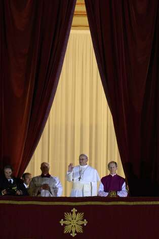Argentina's Jorge Bergoglio, elected Pope Francis I (C) appears at the window of St Peter's Basilica's balcony after being elected the 266th pope of the Roman Catholic Church on March 13, 2013 at the Vatican. Photo: ANDREAS SOLARO, Getty / 2013 AFP