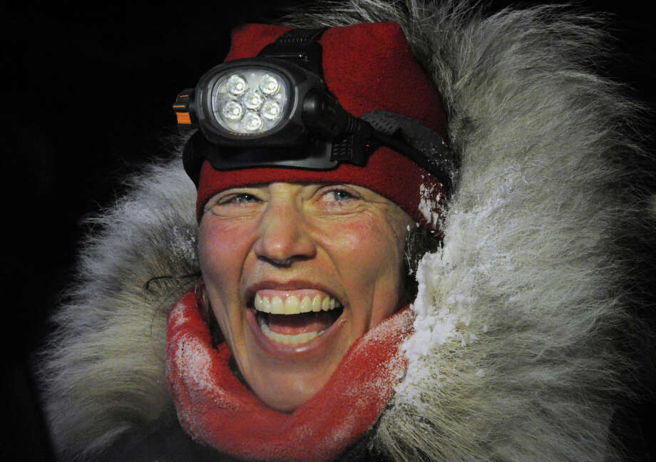 Aliy Zirkle finishes second in the Iditarod for the second consecutive year when her dog team crossed under the burled arch in Nome, Alaska on Tuesday evening, March 12, 2013. Photo: Bill Roth, McClatchy-Tribune News Service / Anchorage Daily News