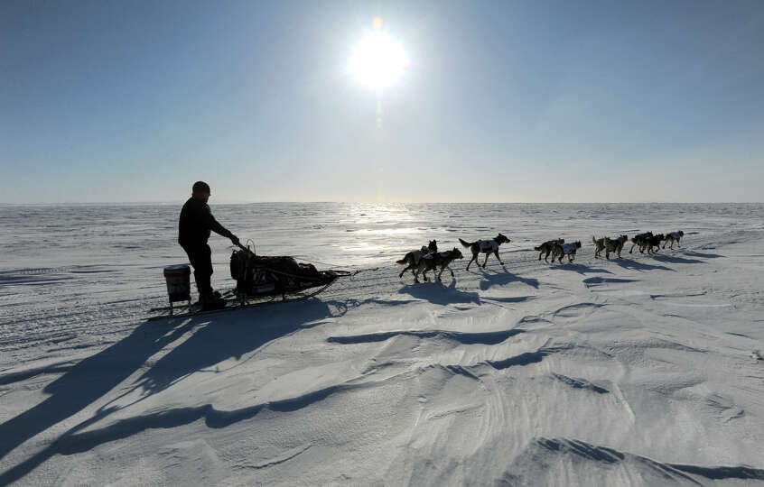 Aily Zirkle drives her dog team towards Elim after leaving the checkpoint at Koyuk in Alaska  during