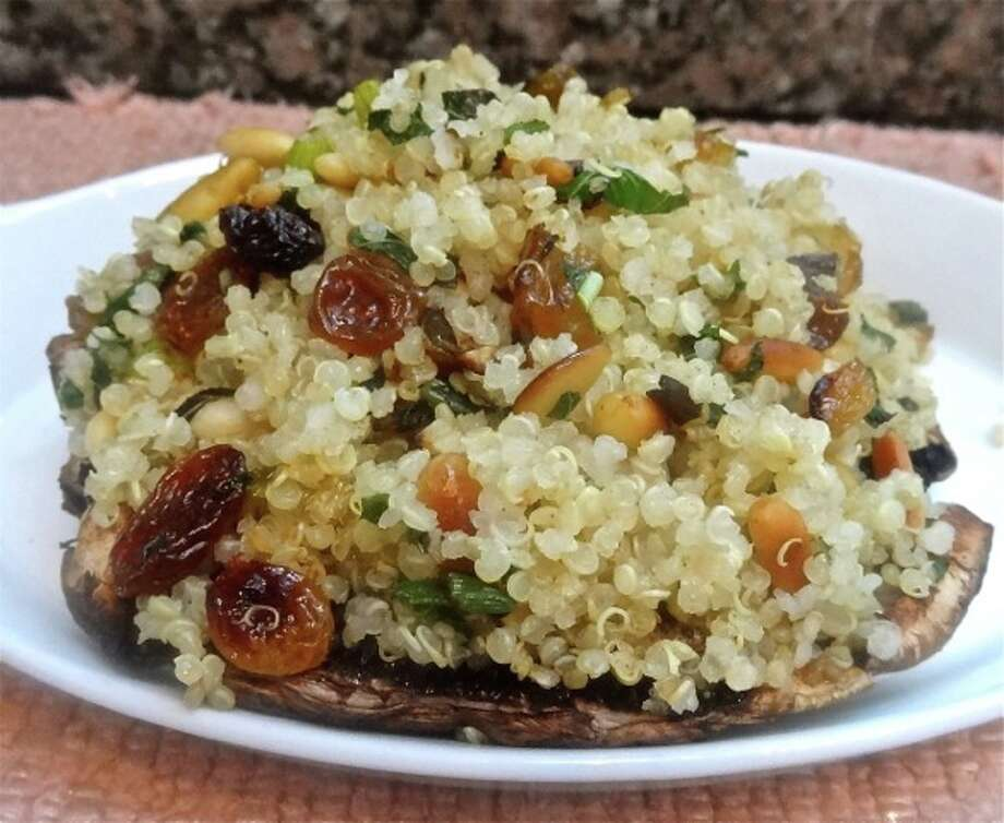 Quinoa-Stuffed Portobello Mushroom Caps with Raisins and Pignoli Nuts (Ronnie Fein/Hearst Newspapers)