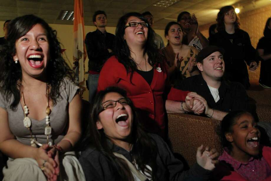 Students watch the pope announcement at St. Thomas University in Houston Wednesday, March 13, 2013. Photo: Johnny Hanson / Houston Chronicle
