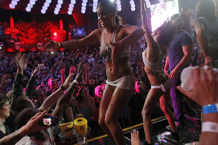 No doubt thrilled about the election of a new pope,spring break revelers celebrate on stage during a wet T-shirt contest at a nightclub in Cancun, Mexico. Photo: Israel Leal, Associated Press