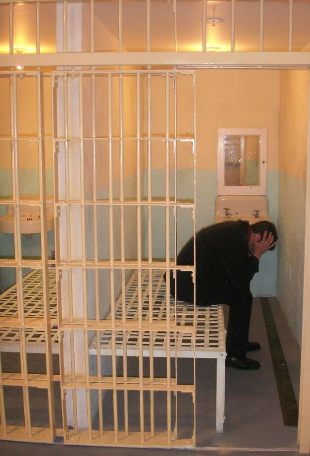 Replica of a cell on Alcatraz, with curator, Barry Barsamian, hamming it up for the camera.
