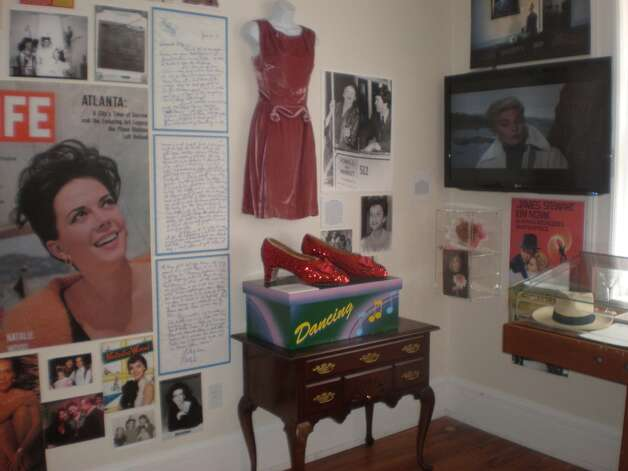 Judy Garland dress and FAO Schwarz mechanical ruby slippers display from the collection of Barry Barsamian.