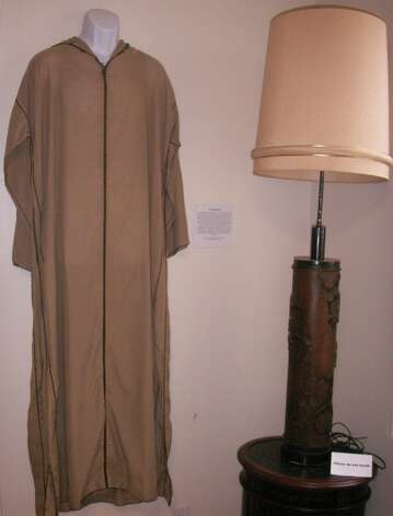 Rock Hudson's caftan (a Halloween costume) and antique lamp, from the collection of Barry Barsamian.