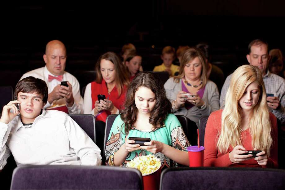 Bad behavior from theater audiences that draws attention from the stage or screen seems to have gotten worse with the help of technology. Photo: Getty Images