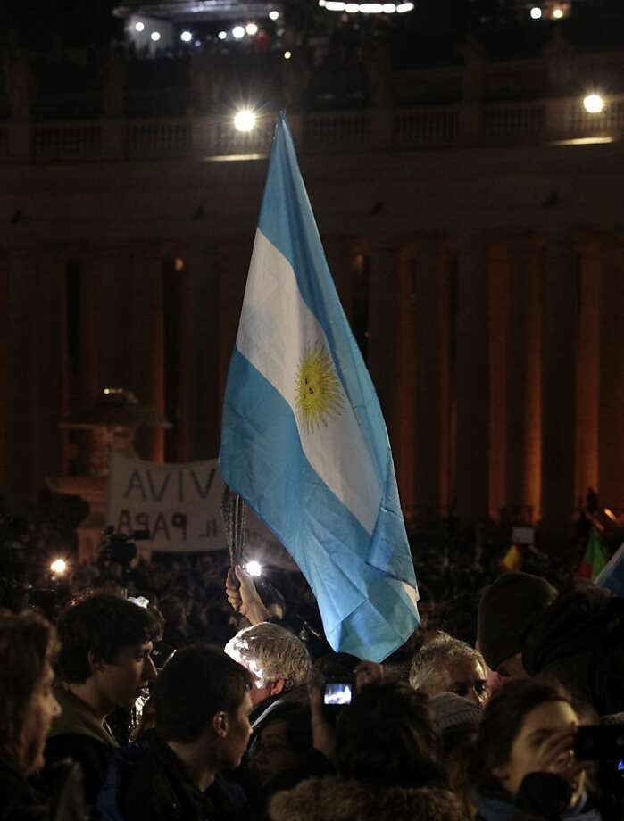 Faithful wave an Argentine flag in St. Peter's Square at the Vatican, Wednesday, March 13, 2013. Cardinal Jorge Bergoglio who chose the name of  Francis, was elected on Wednesday the 266th pontiff of the Roman Catholic Church. (AP Photo/Gregorio Borgia) Photo: Gregorio Borgia, Associated Press