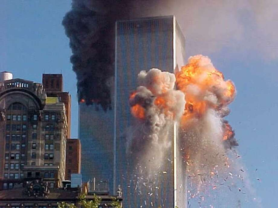A fireball explodes from one of the World Trade Center towers after a jet airliner crashed into the building Tuesday, Sept. 11, 2001, in New York. (AP Photo/Carmen Taylor via KHBS/KHOG-TV) Photo: CARMEN TAYLOR, AP / KHBS KHOG