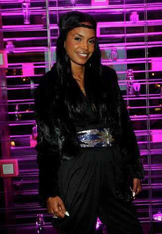Kim Porter attends Victoria's Secret SWIM 2013 Party hosted by Victoria's Secret angels Alessandra Ambrosio, Candice Swanepoel, and Karlie Kloss at a private residence on March 12, 2013 in Beverly Hills, California. Photo: Donato Sardella, WireImage / 2013 Donato Sardella
