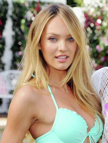 Victoria's Secret model Candice Swanepoel poses at the Victoria's Secret 2013 Swim Collection Debut on March 12, 2013 in Los Angeles, California. Photo: Jon Kopaloff, FilmMagic / 2013 Jon Kopaloff