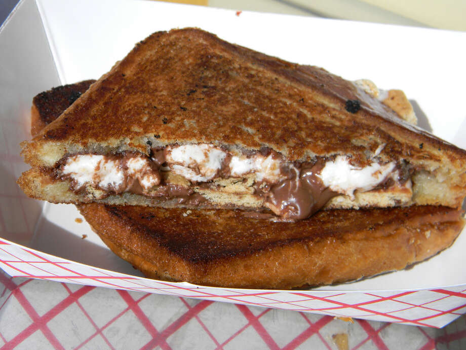 The Golden Grill food truck also produces a sweet sandwich called simply S more. In between two slices of Texas toast is Nutella, graham crackers and marshmallow pieces. It s a bite bound to bring back memories of sitting around a campfire. Photo: Paul Galvani
