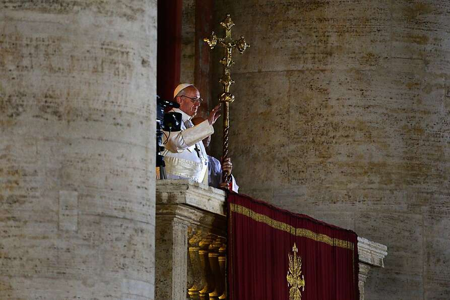VATICAN CITY, VATICAN - MARCH 13:  Newly elected Pope Francis I appears on the central balcony of St