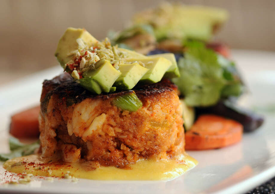 Visit Citrus in the Hotel Valencia on Houston Street and you'll find crab cakes with avocado on the menu. Photo: Express-News File Photo