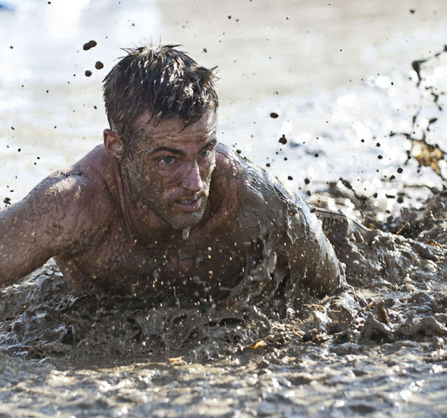 Jailbreak San Antonio requires participants to navigate wet, muddy obstacles. Photo: Courtesy Photo