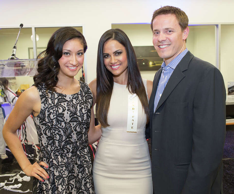 Kaitlyn Muñoz, from the left, Cassandra Lazenby and Chad Forcier get together at the Leukemia & Lymphoma Society 2013 Man & Woman of The Year kick-off party at BMW of San Antonio, Thursday, March 7, 2013. Photo: J. MICHAEL SHORT, FOR THE EXPRESS-NEWS / SAN ANTONIO EXPRESS-NEWS