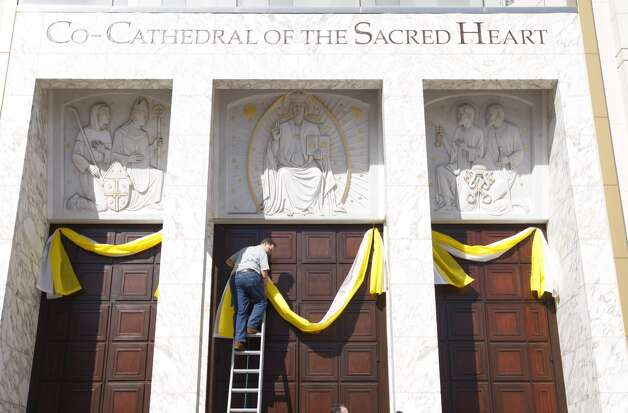 Baners with the pope's colors are raised in honor of Pope Francis, who was selected March 13, 2013.