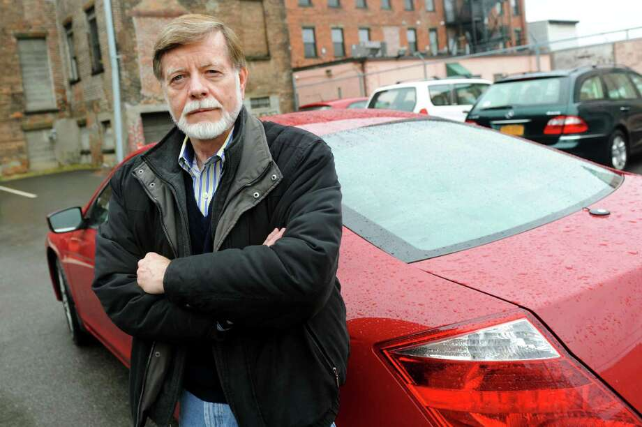 "Bill Westwood, standing with a car that was vandalized a year ago, believes that Albany police failed to aggressively investigate the crime. ""I don't think that people should be afraid ... of leaving property in public places,"" he said. (Cindy Schultz / Times Union) Photo: Cindy Schultz / 00021510A"