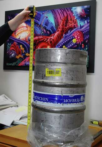 Albany resident Bill Westwood believes this beer keg was used to vandalize his Honda Accord on March 6, 2012. To his frustration, police have not charged anyone with the crime. (Photo provided by Bill Westwood)