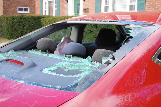 When vandals attacked Bill Westwood's car on March 6, 2012, the $8,000 in total damage included broken windows and dents. Westwood concluded that a empty beer keg was used in the attack and is frustrated that police have not made an arrest. (Photo provided by Bill Westwood)