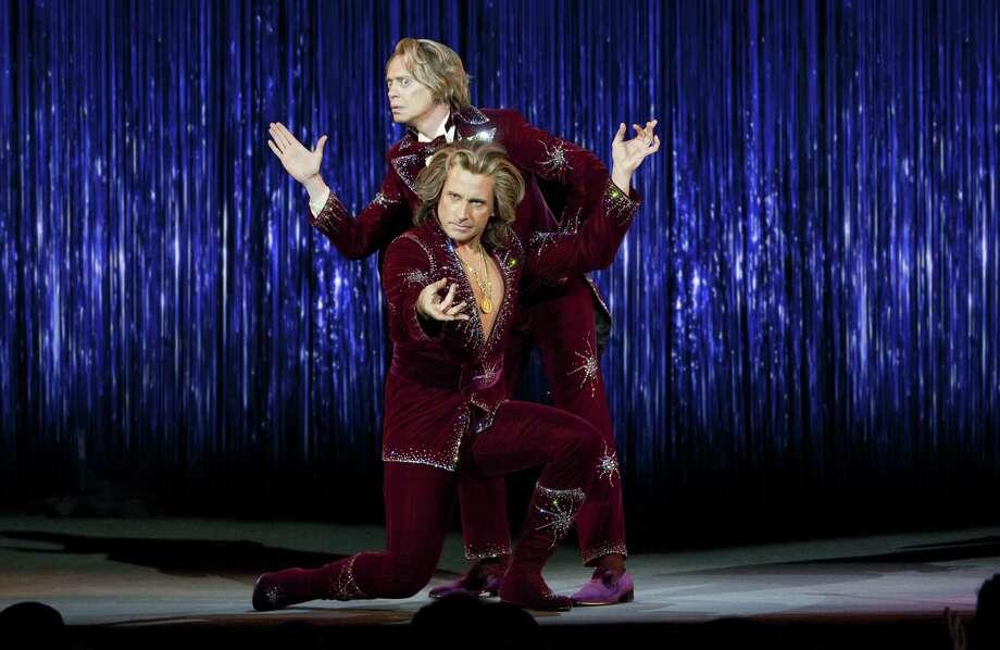 "Steve Buscemi (top) plays Anton Marvelton and Steve Carell portrays Burt Wonderstone, partners in a Vegas magic act, in ""The Incredible Burt Wonderstone."" Photo: Ben Glass / Warner Bros. Pictures"