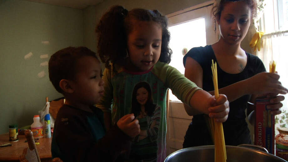 Barbie Izquierdo of North Philadelphia makes dinner with her kids. Photo: Magnolia Pictures