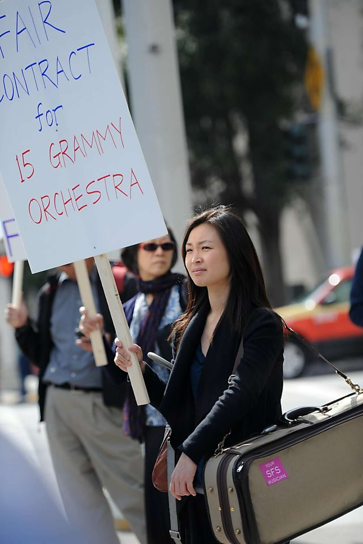Insun Jang a violin player with the symphony strikes outside of Davies Symphony Hall in San Francisco on Wednesday, March 13, 2013.