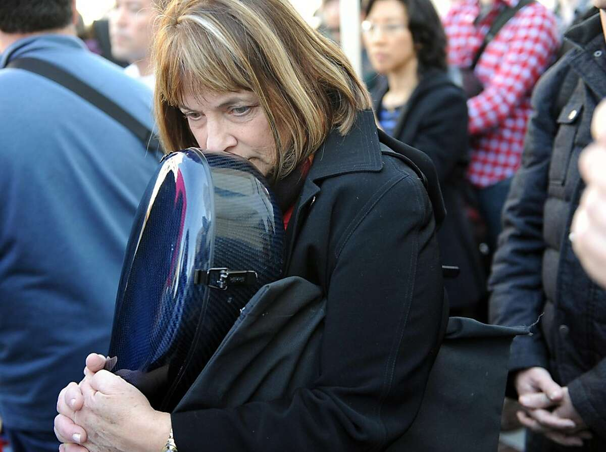 Anne Pinsker, who plays the cello with the symphony, strikes outside of Davies Symphony Hall in San Francisco on Wednesday, March 13, 2013.