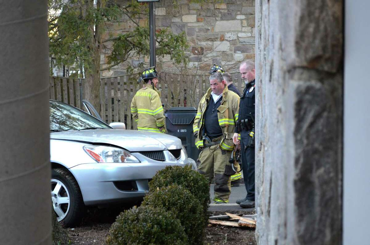Emergency personel reported to a motor vehicle accident in the back of the New Canaan Library. Damage to building was minimal.