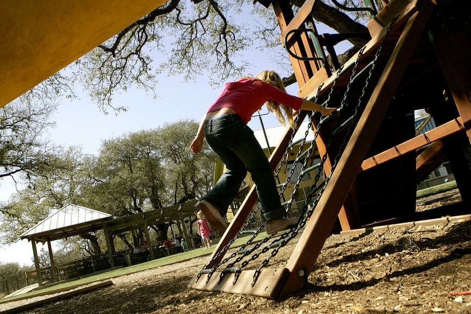 MoMak's Backyard Malts and Burgers, 13838 Jones Maltsberger Road, 210-481-3600, offers a fenced-in, 8,000-square-foot artificial turf sport field and a 14-foot playscape treehouse for kids to play. Photo: Express-News To File Photo