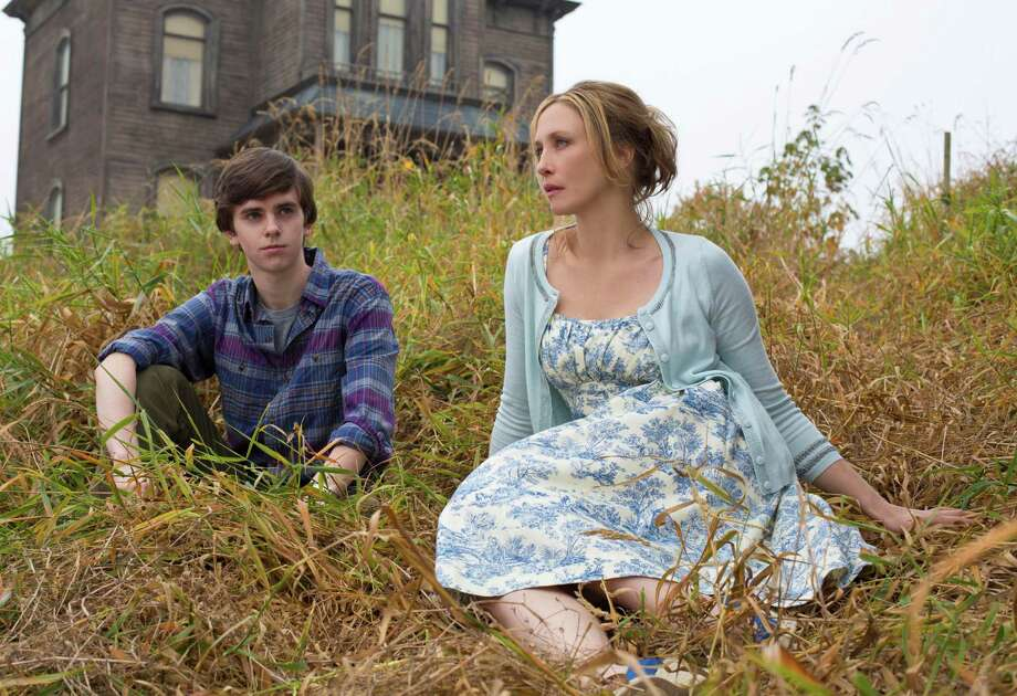 "Norman Bates (Freddie Highmore) and his mother, Norma (Vera Farmiga), make a new life for themselves in tiny White Pine Bay in the new A&E thriller ""Bates Motel."" Photo: Joe Lederer, Handout / ONLINE_YES"