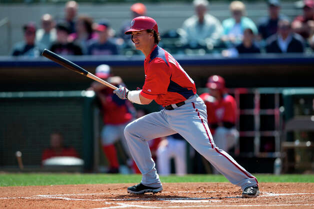 Nationals SS Zach Walters takes off out of the batter's box after contact. Photo: Evan Vucci, Associated Press / AP