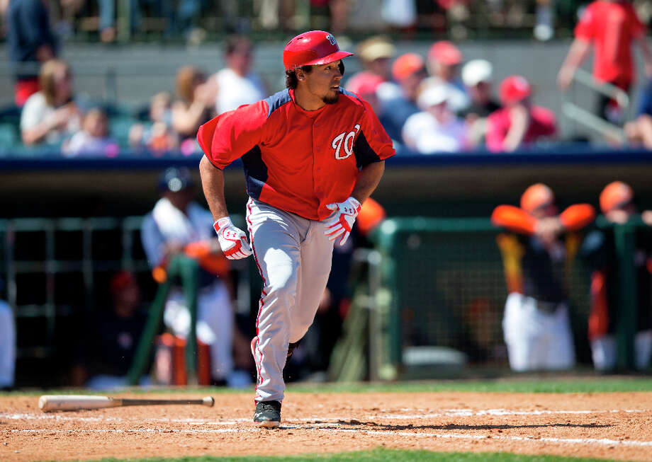 Nationals infielder Anthony Rendon watches a double as he trots towards first base. Photo: Evan Vucci, Associated Press / AP