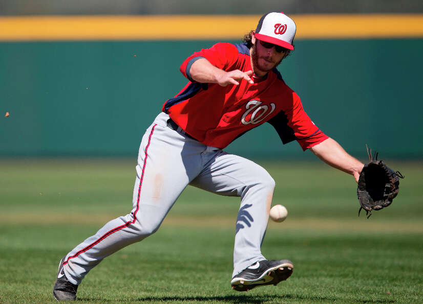 Nationals infielder Will Rhymes fields a ground ball during the fourth inning.
