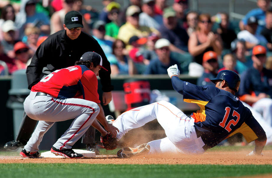 Astros 1B Carlos Pena is tagged out by Nationals infielder Anthony Rendon. Photo: Evan Vucci, Associated Press / AP