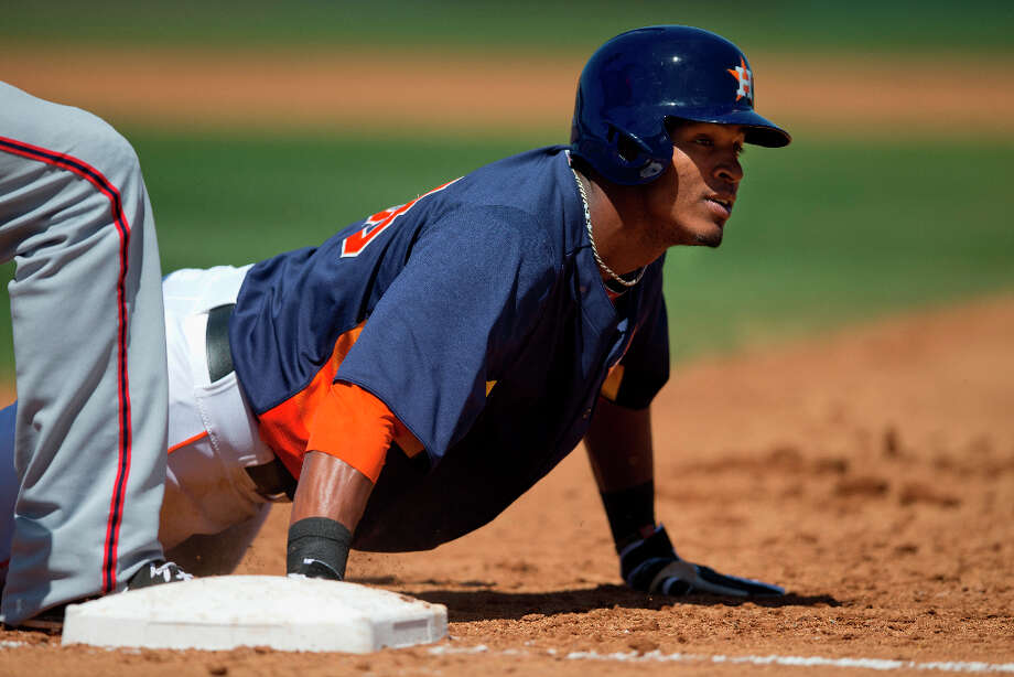 Astros outfielder Jimmy Paredes slides back to first base during a pickoff attempt. Photo: Evan Vucci, Associated Press / AP