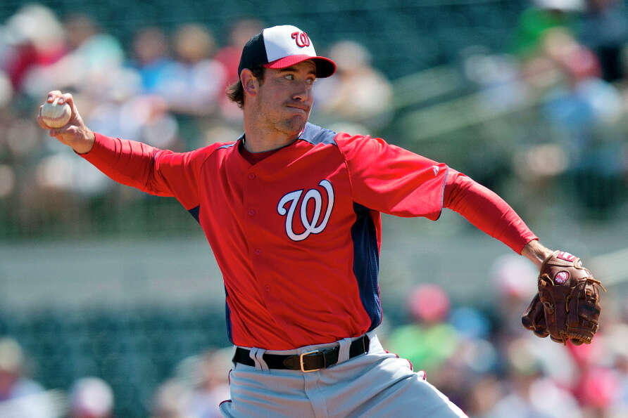 Nationals pitcher Ross Ohlendorf delivers a pitch towards an Astros batter.
