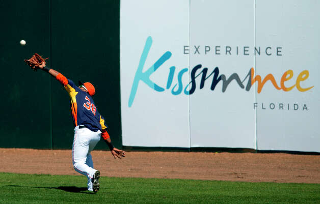 Astros outfielder Jimmy Paredes makes a catch during the fourth inning. Photo: Evan Vucci, Associated Press / AP