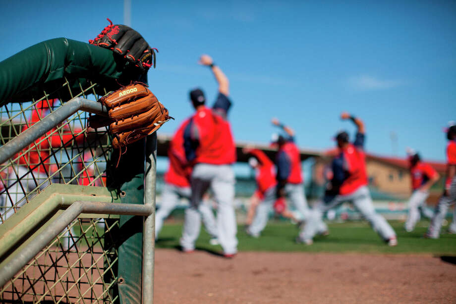 Nationals players warm up before the start of an spring training matchup with the Astros. Photo: Evan Vucci, Associated Press / AP