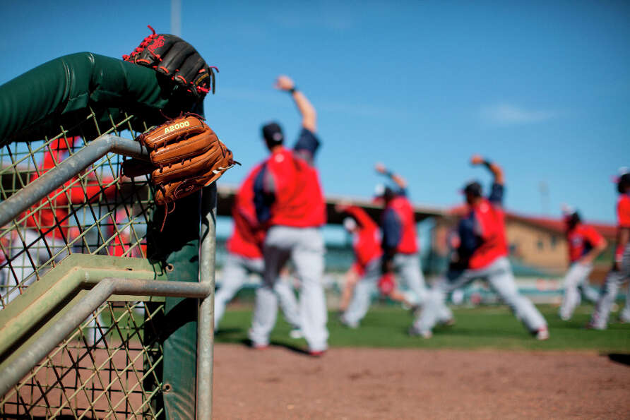 Nationals players warm up before the start of an spring training matchup with the Astros.