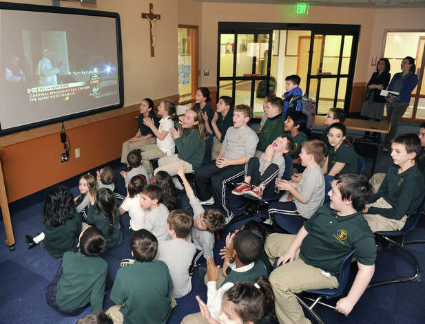 Children at St. Thomas the Apostle School in Delmar clap and cheer as they watch the announcement of the new Pope on a large screen in the media room at the school on Wednesday, March 13, 2013 in Delmar, N.Y. Cardinal Bergoglio of Argentina has chosen the name Pope Francis. (Lori Van Buren / Times Union) Photo: Lori Van Buren
